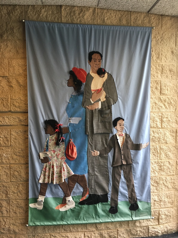 Welcome tapestry depicting family designed by Jan Spivey-Gilchrist.